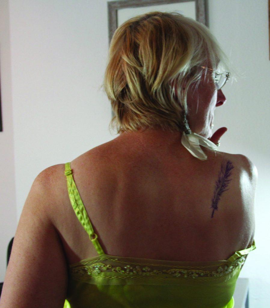 Davina Kirkpatrick being tattooed by Radu Rusu, Truro Cornwall photographed by Karen Abadie