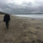 Carol walking on Hayle beach