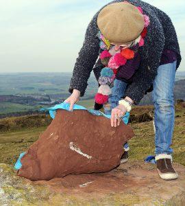 peeling clay from the whetstone